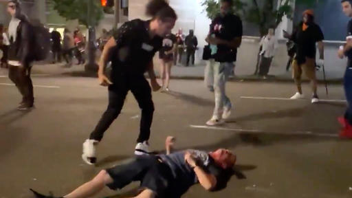 Antifa Kicking Man